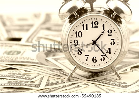 Time - money. Business concept. Analog hours on a heap of paper dollars. Old tone - stock photo
