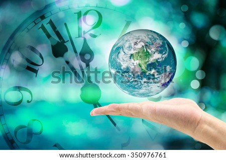 Time, nature and environment concept. Close Up of globe on blue clock face background