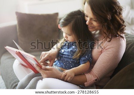 Time only for mother and her little daughter - stock photo