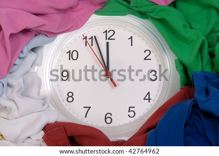 Time - Pile of dirty clothes for the laundry - stock photo