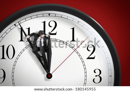 Time pressure. Deadline. Businessman trying to stop time. Time Management.  - stock photo