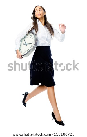 Time running away concept with businesswoman holding clock and jumping isolated on white background - stock photo