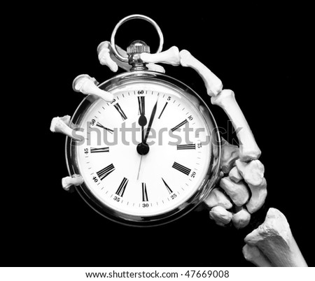 time's up! skeleton hand holds pocket watch, slight movement in the minute hand - stock photo