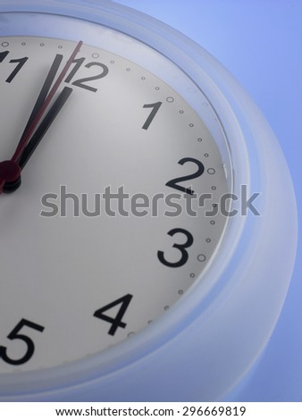Time shows One Minute to twelve - stock photo
