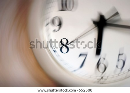Time spinning by fast on a clock - stock photo