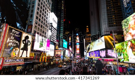 Time Square, New York, April 8, 2016, Times Square is a major landmark of New York,  brightly adorned with billboards and advertisements.