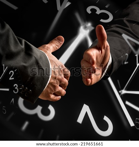 Time Themed Image of Business Handshake with Clock Overlays. - stock photo