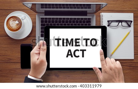 TIME TO ACT , on the tablet pc screen held by businessman hands - online, top view - stock photo