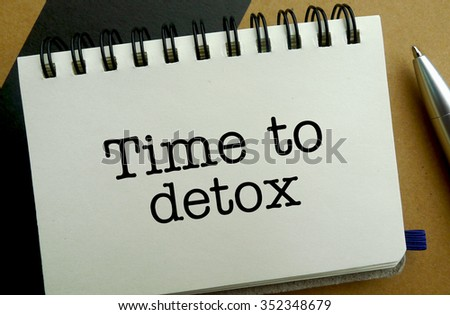 Time to detox memo written on a notebook with pen
