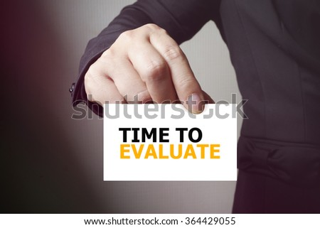 TIME TO EVALUATE paper on the card , business concept , business idea - stock photo