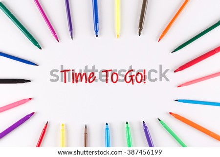 Time To Go written on white background with multi colored pen