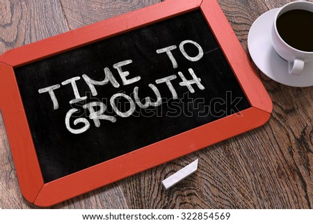 Time to Growth Concept Hand Drawn on Red Chalkboard on Wooden Table. Business Background. Top View. - stock photo