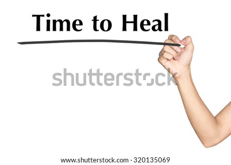 Time to Heal Man hand writing virtual screen text on white background - stock photo