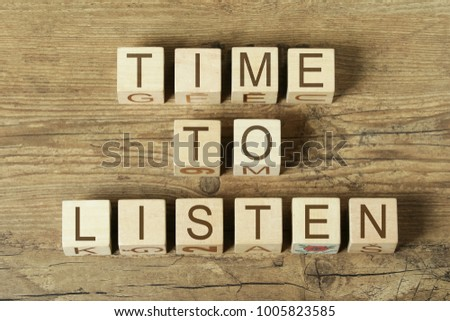 time to listen text on wooden cubes