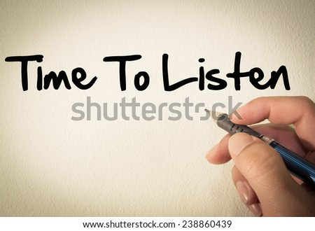 Time to listen text write on wall