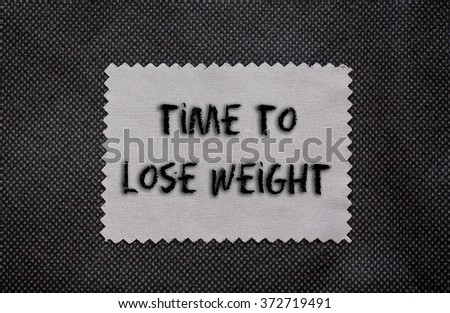 Time to lose weight words written on a chalkboard
