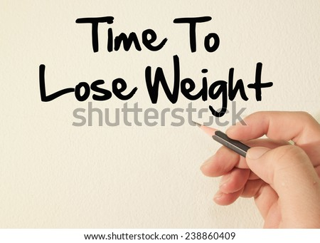 Time to lose weight write on wall  - stock photo