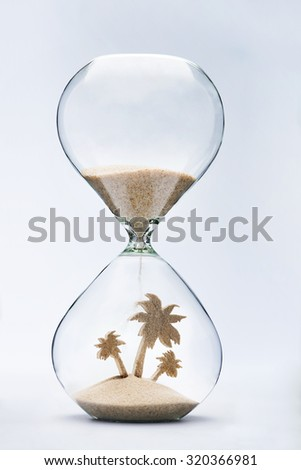 Time to make plans for summer vacation. Hourglass falling sand taking the shape of a palm tree - stock photo