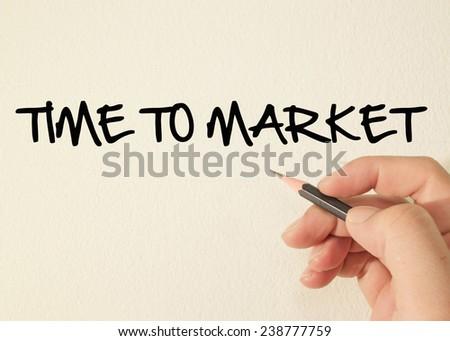 Time to market write on wall  - stock photo