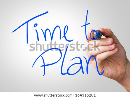 Time to Plan hand writing with a blue mark on a transparent board - stock photo