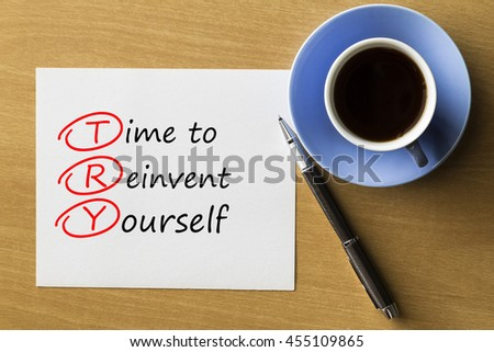 Time to Reinvent Yourself - handwriting on paper with cup of coffee and pen, acronym business concept