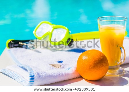 Time to relax. Leisure at the pool, cool drinks in the summer day.