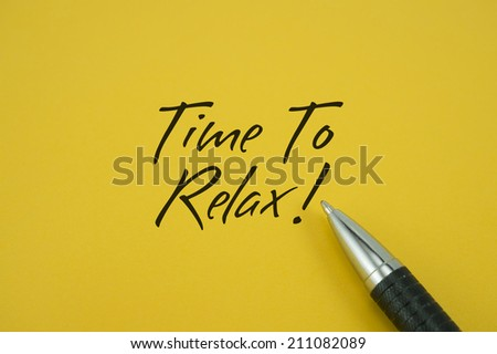 Time To Relax! note with pen on yellow background