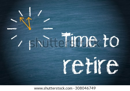 Time to retire - clock with text on blue background - stock photo