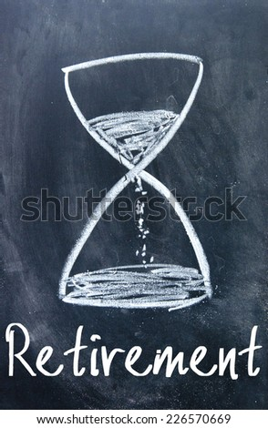 time to retire sign on blackboard - stock photo
