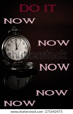 time to save time concept clock closeup on black background with red and black words - stock photo