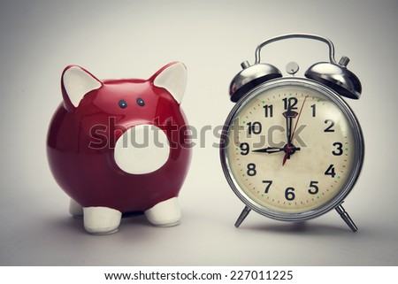 Time to savings money on the white background. Isolated on white - stock photo