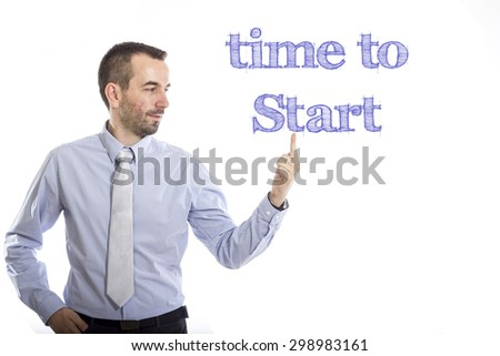 Time to start Young businessman with small beard touching text