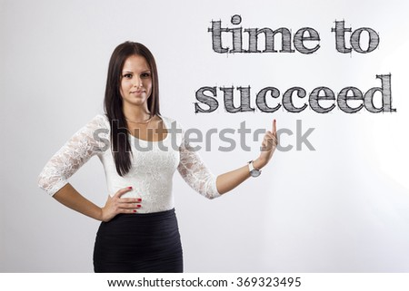 Time to succeed  - Beautiful businesswoman pointing - horizontal image