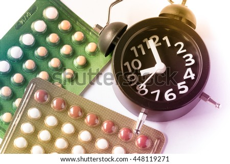 Time to take brith control pill on pastel filter style - stock photo