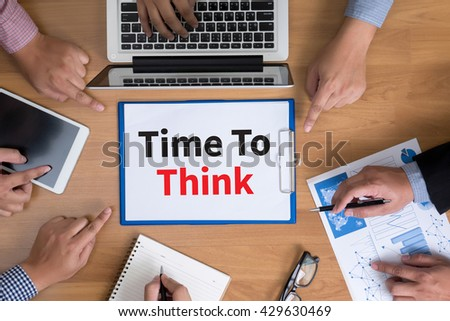 Time To Think Business team hands at work with financial reports and a laptop, top view - stock photo