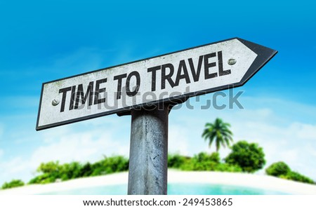 Time to Travel sign with a beach on background - stock photo