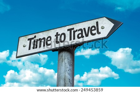 Time to Travel sign with sky background - stock photo