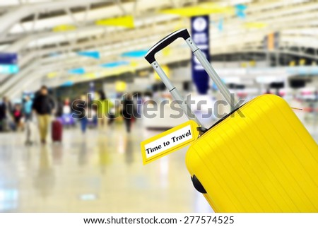 Time to Travel. Suitcase with label at airport. - stock photo