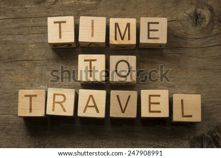 Time to Travel text on a wooden cubes - stock photo