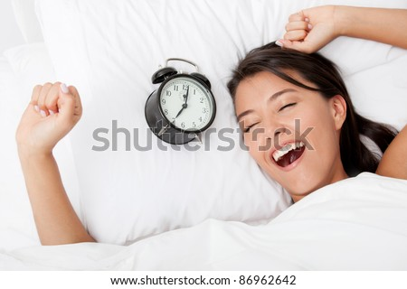 Time to wake up for a beautiful woman sleeping - stock photo