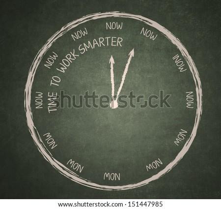 Time to work smarter clock written on the blackboard - stock photo