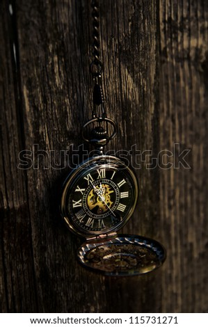 Time - Vintage Pocket Watch on Weathered Wood Background - stock photo