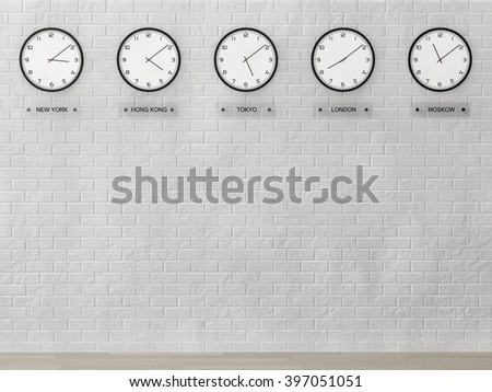 Time Zone Clocks showing different time in front of brick wall - stock photo