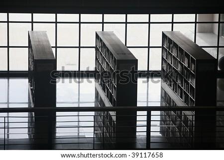Timeless bookshelves in library - stock photo