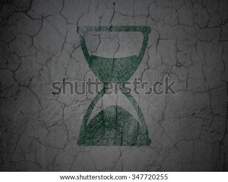 Timeline concept: Green Hourglass on grunge textured concrete wall background - stock photo