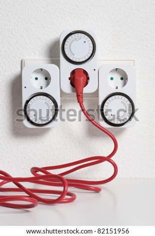 Timer switch saving energy and money - stock photo