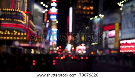 Times Square lights at night/Times Square at Night/Blurred image of Times Square traffic, lights and pedestrians at night - stock photo