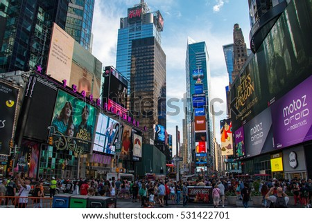 TIMES SQUARE, NEW YORK CITY - AUGUST 6, 2016: Times Square is a major commercial intersection and neighborhood in Midtown Manhattan, New York City, at the junction of Broadway and Seventh Avenue