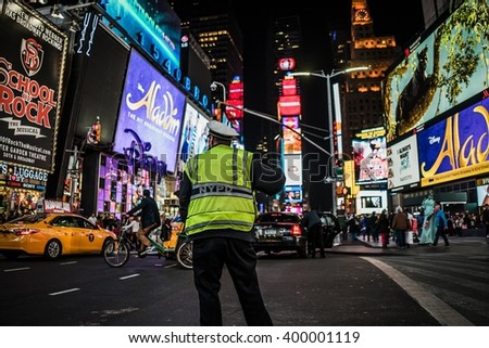 Times Square, New York City, United States of America - Circa March 2016 - A selective focus shot of a NYPD police officer on times square