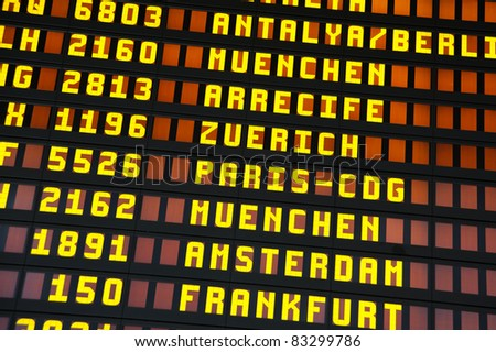 Timetable at the airport, showing flight numbers and destinations - stock photo